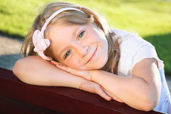 Smiling little girl portrait at a park Stock Image