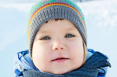Smiling little girl portrait at winter in warm clothes Royalty Free Stock Photo