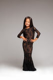 Smiling little girl posing in black lace dress Stock Photos