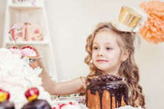 Smiling little girl posing in golden hat Royalty Free Stock Image