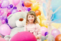 Smiling little girl posing in playroom Stock Images
