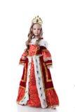Smiling little girl posing in royal dress stock image