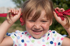 A smiling little girl presenting Pippi Longstocking Royalty Free Stock Photos