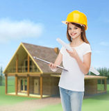 Smiling little girl in protective helmet. Childhood, construction, architecture, building and people concept - smiling little girl in protective helmet with Royalty Free Stock Images