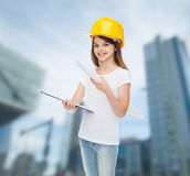 Smiling little girl in protective helmet. Childhood, construction, architecture, building and people concept - smiling little girl in protective helmet with Stock Photos