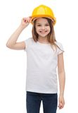 Smiling little girl in protective helmet. Construction and people concept - smiling little girl in protective helmet Royalty Free Stock Photography