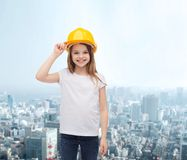 Smiling little girl in protective helmet. Construction and people concept - smiling little girl in protective helmet Royalty Free Stock Images