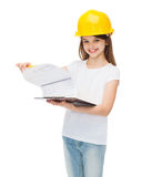 Smiling little girl in protective helmet. Construction and people concept - smiling little girl in protective helmet with clipboard Stock Image