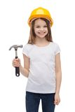 Smiling little girl in protective helmet. Construction and people concept - smiling little girl in protective helmet with hammer Stock Photos
