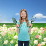 Smiling little girl with rake and scoop Royalty Free Stock Images