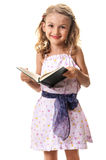 Smiling little girl reading a book Royalty Free Stock Photo