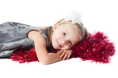 Smiling  little girl with red decoration Stock Photos