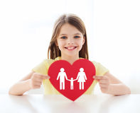 Smiling little girl with red heart and family Stock Images