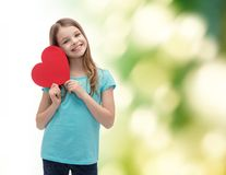 Smiling little girl with red heart stock photos