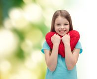 Smiling little girl with red heart Royalty Free Stock Photography