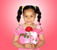 Smiling little girl with a red rose. For gift on a over pink background Royalty Free Stock Images