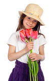 Smiling little girl with red tulips Royalty Free Stock Photography