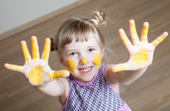Smiling little girl represents as sun Stock Photography