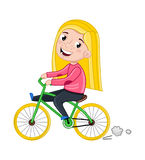 Smiling little girl riding on bicycle Stock Image