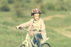 Smiling little girl riding a bike Royalty Free Stock Photos