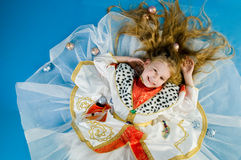 Smiling little girl in royal clothes Stock Photo