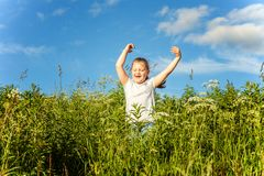 Smiling little girl running Stock Images