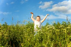 Smiling little girl running Stock Photography