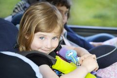 Smiling little girl safety belt car security chair Royalty Free Stock Photo