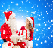 Smiling little girl with santa claus and gifts Stock Photo