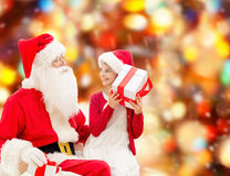 Smiling little girl with santa claus and gifts Royalty Free Stock Image