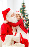 Smiling little girl with santa claus Royalty Free Stock Photo