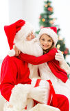 Smiling little girl with santa claus Royalty Free Stock Photography