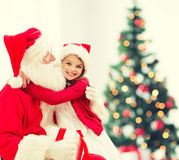 Smiling little girl with santa claus Stock Photography