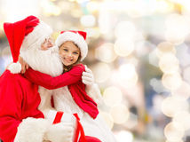 Smiling little girl with santa claus Stock Image