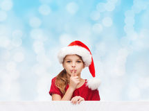 Smiling little girl in santa helper hat Stock Photography