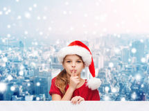 Smiling little girl in santa helper hat Royalty Free Stock Photos
