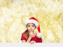 Smiling little girl in santa helper hat Stock Photography