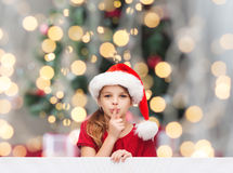 Smiling little girl in santa helper hat Stock Image