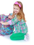 Smiling little girl with school bag. Happy childhood, the family concept.Smiling little girl with school bag.Isolated on white Stock Images