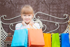 Smiling  little  girl  after shopping Royalty Free Stock Photography