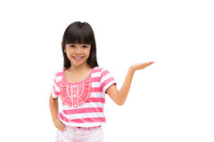 Smiling little girl showing empty hand Stock Image
