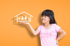 Smiling little girl showing on family symbol Stock Image