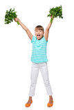 Smiling little girl showing fresh parsley screaming of joy Royalty Free Stock Photos