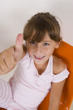 Smiling Little Girl Showing Thumb S Up Stock Image