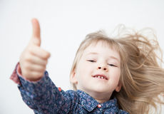 Smiling little girl showing thumb up Stock Photography