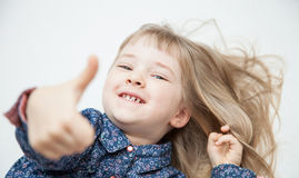 Smiling little girl showing thumb up Royalty Free Stock Photo