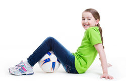 Smiling little girl sitting with ball. Stock Photography