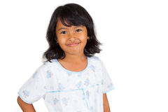 A smiling little girl with sleeping dress. royalty free stock photos