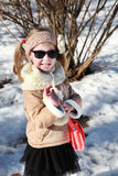 A smiling little girl in snow Stock Image