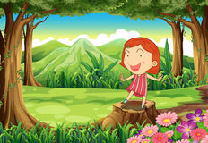 A smiling little girl standing above the stump Stock Images